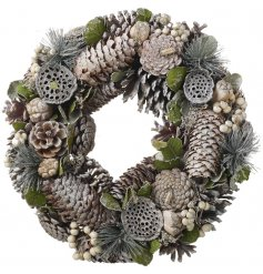 Assortments of pinecones, berries, walnuts and other woodland foliage builds up this beautifully finished winter wreath