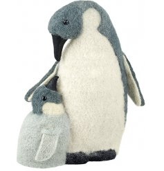 Bring a winter wonderland feel to your home interior or displays with this adorable gazing momma and baby penguin decora