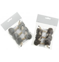 Hang your christmas cards in style with this cute assortment of fuzzy hedgehog pegs