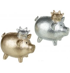 An assortment of 2 Silver/Gold Resin Piggy Banks