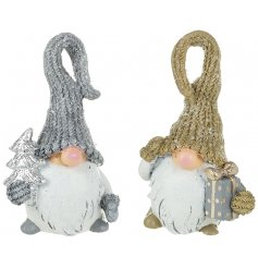 An assortment of 2 Large Silver/Gold Santas In Hats