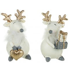 An assortment of 2 White & Gold Reindeer Decorations
