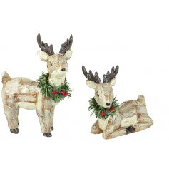 An assortment of 2 Polyresin Deer With Wreaths
