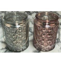 An assortment of 2 Pink/Silver Glass Tealight Lanterns