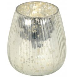 Set with a silver speckled glaze, this Luxe inspired candle holder will be sure to produce a beautiful homely glow