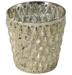 this glass candle pot will be sure to bring a charming edge to any home interior