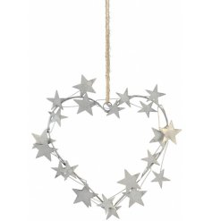 Set with a cut metal star decal, this hanging heart decoration will be sure to add a rough luxe edge to any home display
