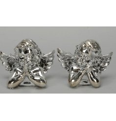 Add an angelic touch to your Christmas set ups or display with this sweet assortment of silver coated cherubs