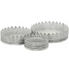 A set of 3 antique inspired crown trays with a grey wash, distressed finish.