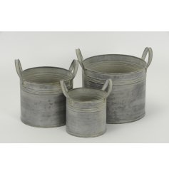 A set of 3 Grey Round Metal Planters