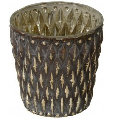 Bring a beautifully distressed Golden Luxe touch to your home decor with this ruggard diamond ridge candle holder