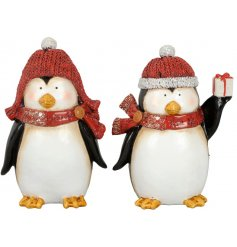 Wrapped up warm in their festive red toned hats and scarves, these little penguin figures are ready for Christmas
