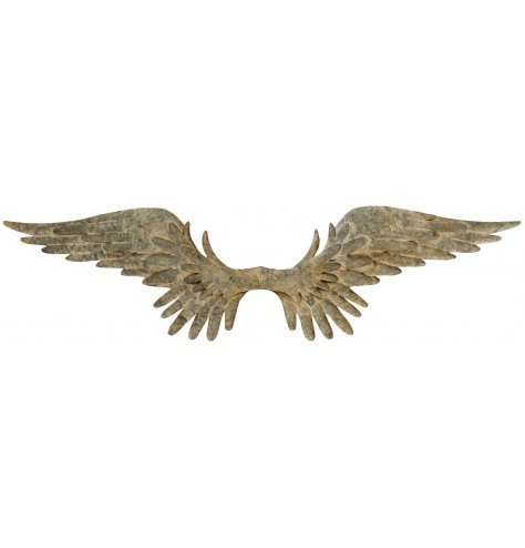 A pair of large angel wings spread open with layered, swooping feathers a distressed finish.