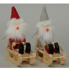 An assortment of 2 Red/Grey Gnomes On Sledges