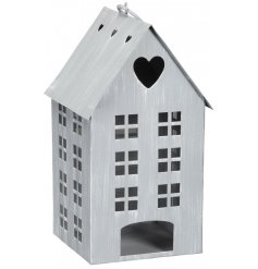 Bring a calming and cozy glow to your home spaces or displays with this beautifully distressed metal house tlight holder
