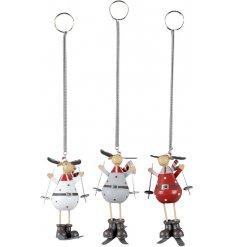 An assortment of 3 Skiing Moose Hanging Decs