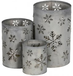 this set of sized candle holders will place perfectly in any themed home space during the festive season