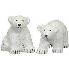 An adorable assortment of posed resin polar bears, perfectly finished with a light sprinkle of glitter