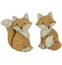 An assortment of 2 Small Resin Fox Decorations