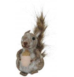 A Felt Squirrel With Acorn Decoration