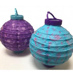 A magical assortment of LED paper lanterns set in a deep ocean blue and purple tone.