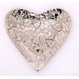 A Silver Heart Bowl With Embossing