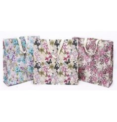 An assortment of 3 Les Fleurs Floral Shopper Bags