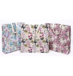 An assortment of 3 Les Fleurs shopping Bags