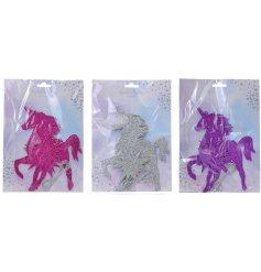 An assortment of 3 Glitter Unicorn Bunting Garlands