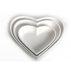 A set of 3 White Wooden Heart Carved Trays