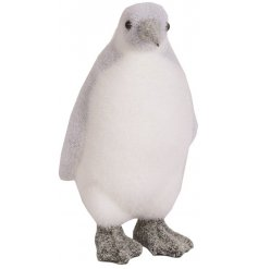 An adorable decorative penguin ornament with a soft glitter finish.