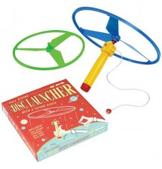 A plastic flying disk launcher complete with 2 coloured sized disks
