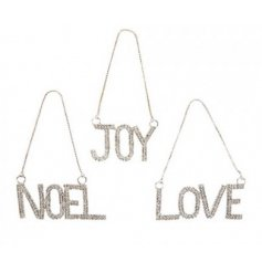 "In the assortments of ""Joy"" ""Love"" and ""Noel"" these super sparkling hanging decorations are a must have!"