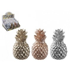 A funky themed assortment of Gold, Silver and Copper toned Metallic pineapple candles,