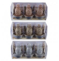 A stylish assortment of metallic toned wax candles in a pineapple form