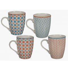 An assortment of 4 Orange/Blue Mexican Pattern China Mugs