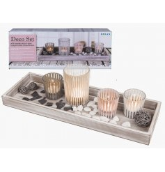 4 glass tealight holders on a decorative wooden tray