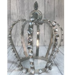 A bedazzled metal crown decoration with an added silver glam
