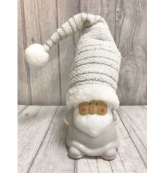 Small standing white Santa with tall silver detailed hat