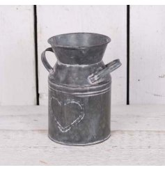 A metal Milk Churn With embossed Heart design