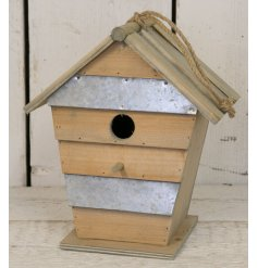 Bring a distressed charm to any garden or tree with this natural toned wooden birdhouse,