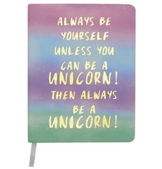 An A5 notebook with Always Be A Unicorn motto