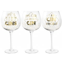 An assortment of 3 Gold Gin Quote Glasses