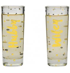 A set of 2 Shot Glasses with gold Hubby & Wife script