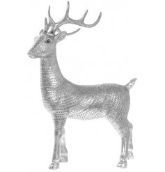 This beautifully decorated silver toned reindeer decoration will be sure to bring a wintered touch to any home interior