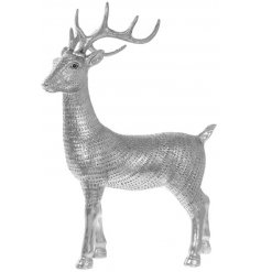 Bring an elegant feel to any home decor this festive season with this beautifully decorated resin reindeer ornament