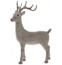 This beautifully decorated neutral toned reindeer decoration will be sure to bring a cozy ambient touch to any home