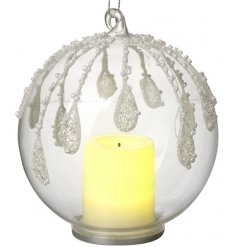 A beautiful illuminating LED bauble set with a snowdrop effect and added candle centre