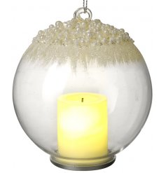 A beautiful illuminating LED bauble set with a sprinkled glitter effect and added candle centre