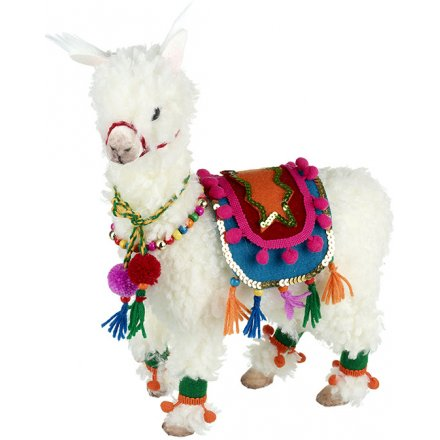 Add a quirky edge to any home decor or display this Christmas season with this Traditionally Decorated Llama figure